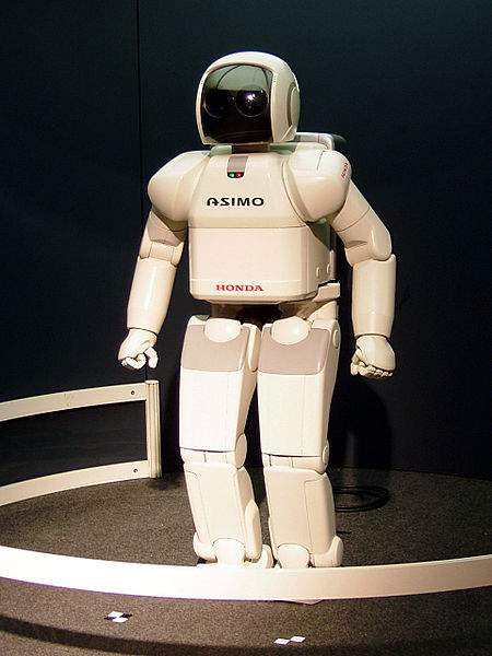 ASIMO  (アシモ) is a humanoid robot created by  Honda . Standing at 130 centimeters and weighing 54 kilograms, the robot resembles a small astronaut wearing a backpack and can walk on two feet in a manner resembling human locomotion at up to 6 km/h. ASIMO was created at Honda's Research & Development Wako Fundamental Technical Research Center in Japan.  Taken by  Gnsin  at  Expo 2005 , in Japan