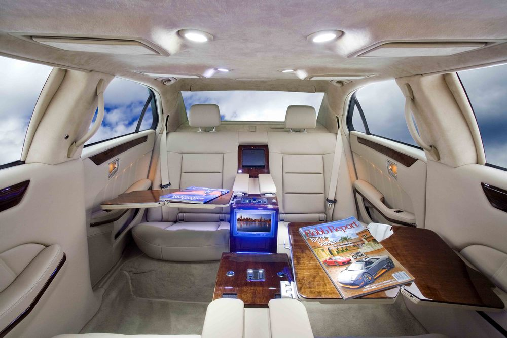 Mercedes S550 Limousine shown with center consoles and aircraft writing desks.