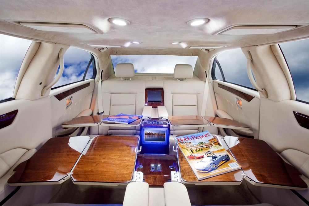 Mercedes S550 Limousine shown with aircraft writing desk option.