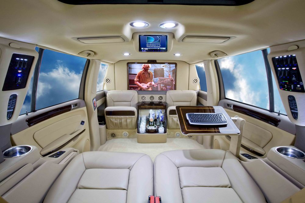 "Mercedes GL Limousine shown with 32"" TV and aircraft writing desk."
