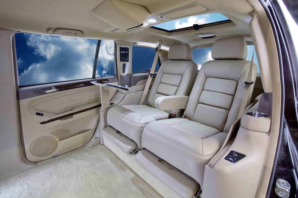 Mercedes GL Limousine shown with electric reclining captain seats.