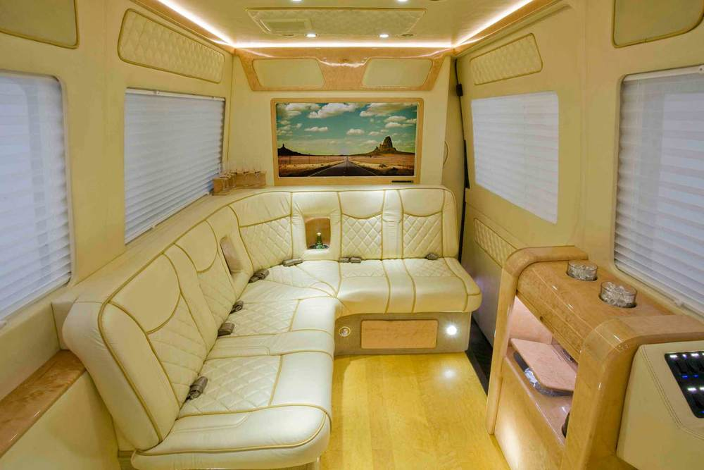 Mercedes Sprinter Van Shown with J-seat and wood floors.