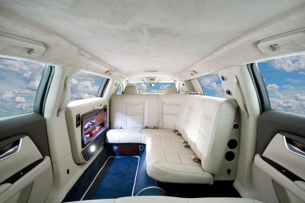 Cadillac XTS Limousine showing J -seat option.