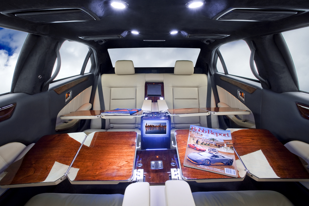Mercedes S550 Limousine shown with aircraft style writing desk option.