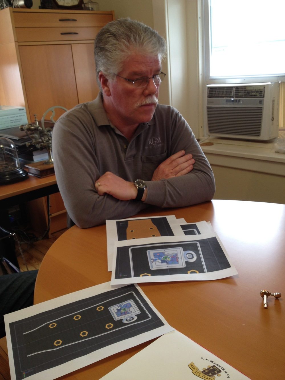 Roland inspecting placement renderings for a one-of-a-kind movement and housing to be mounted within the head stock.