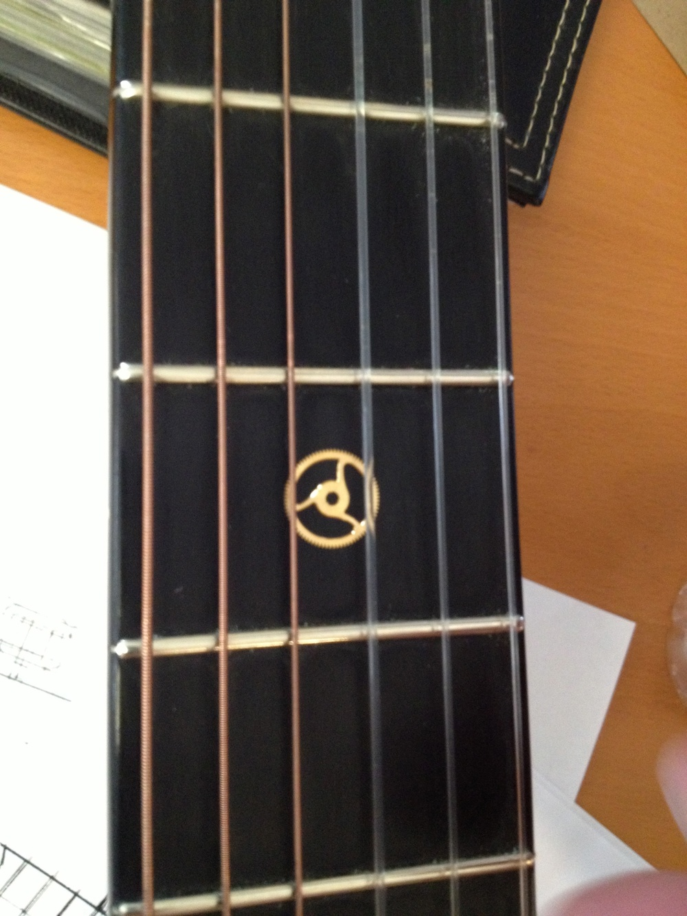 Placement considerations for actual movement pieces on an ebony fret board.