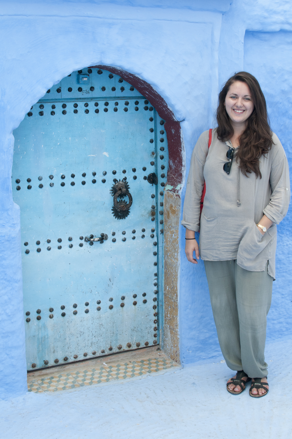 Here I am, standing next to a small blue door in Morocco.
