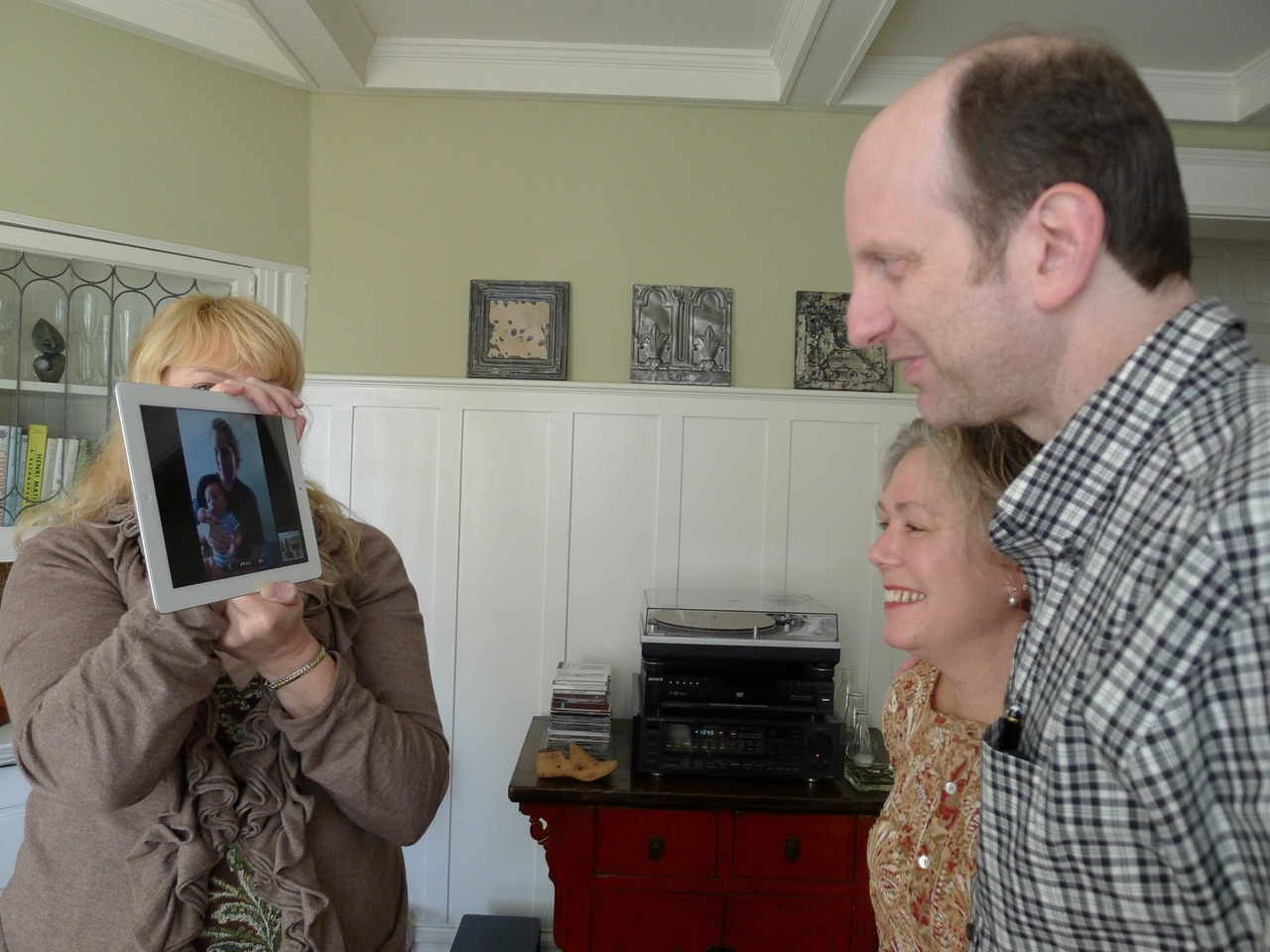 Pop takes photos: Pop was in San Francisco to celebrate my brother's birthday.  We could not attend, given the infant, so we face-timed it in.  Pop took photos of said face-timing. Yes, I am aware that we are all one giant Apple advertisement. The image is so meta, my head might explode.  Now, consider me posting the photo that Pop took of my brother talking to me, and we are really getting in to Ouroboros territory.