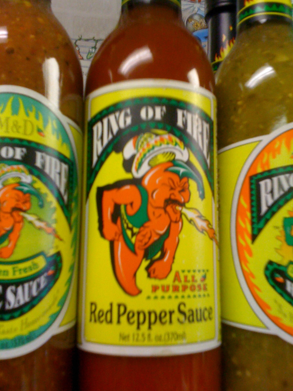"From our ""Found in the Wild"" series:    I'm no advertising guru.  But if you ask me, having a hot pepper vomiting fire as the mascot for your hot sauce is effective and efficient"