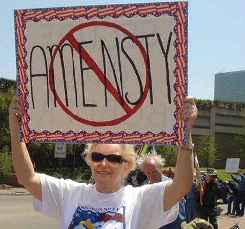 "I can't stand the thought of AMENSTY! Just one of a host of ""Teabonics"" pictures (spelling/grammatical wonders from recent Tea Party Protests)."