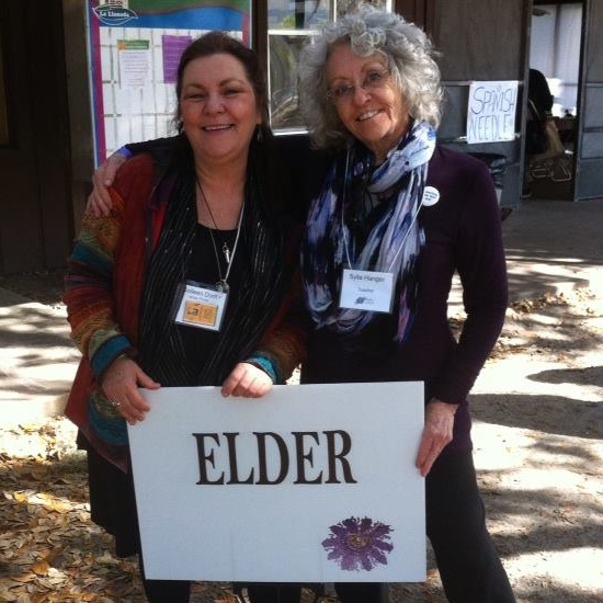 The beautiful and radiant Colleen Dodt and Sylla Hanger at the Florida Herbal Conference. All the classrooms had botanical names and although we were in Spanish Needle, we could not pass up a photo with this sign!