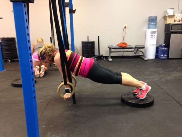 Trisha working the plank ring hold.