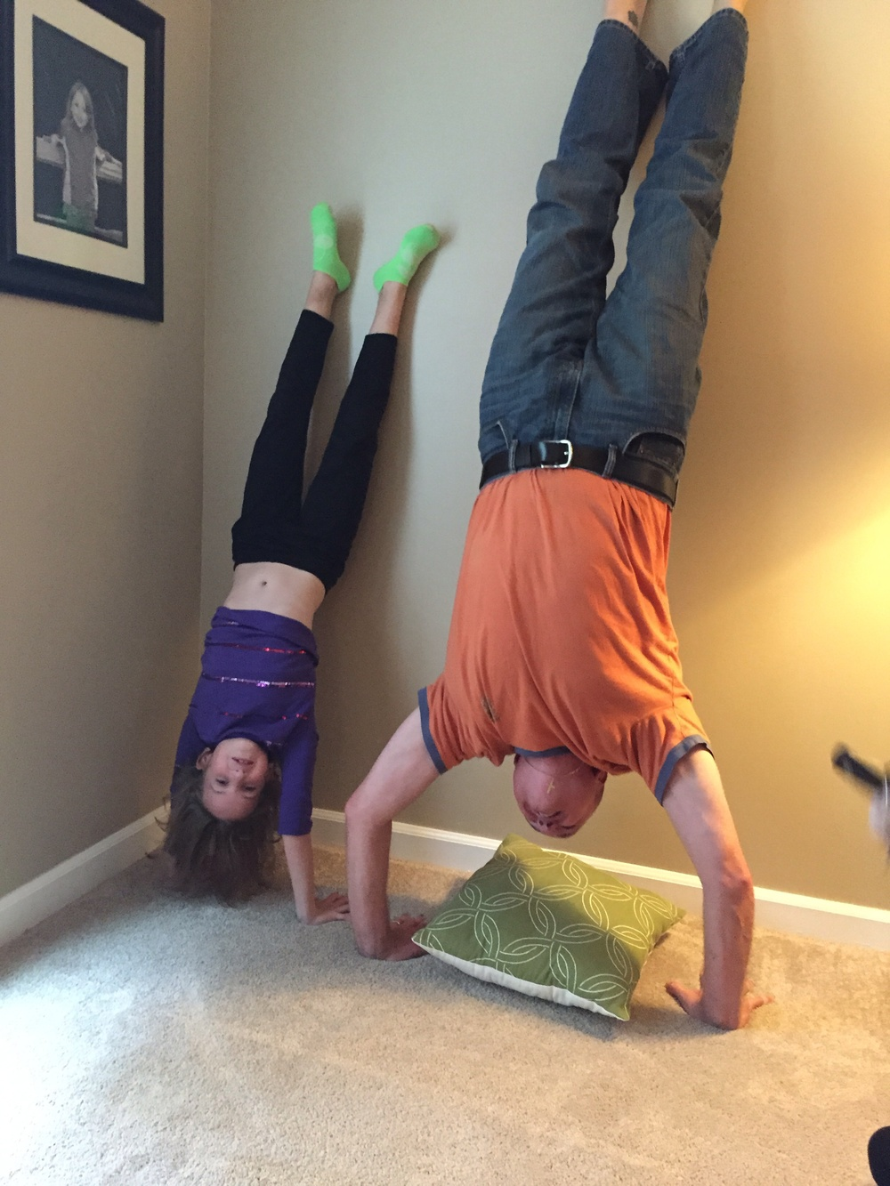 Rob working on his handstands with his daughter!