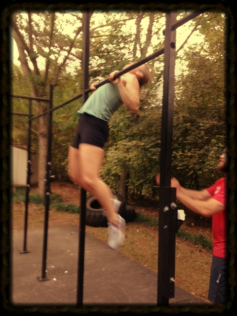Becca working chest to bar pull-ups. When she started CrossFit in September 2012, she was on a blue band.