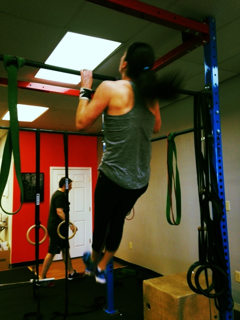 CFJ Athlete Ashley getting working on her pull-ups.