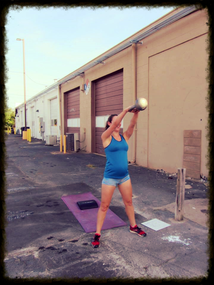 "And our favorite pregnant CrossFitter award goes to...Mo! She is all smiles while working through ""Jane"" on Sunday."