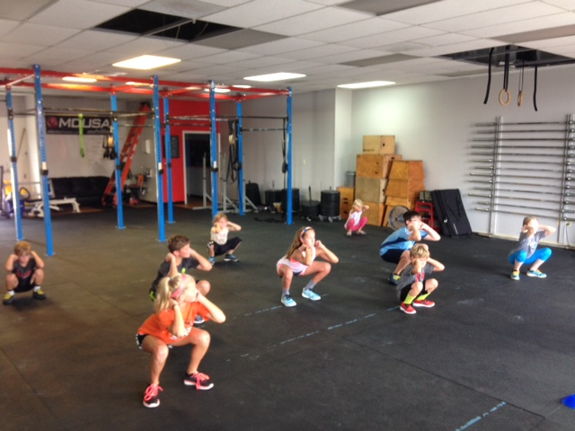 Our CFJ Kids working on front squats!