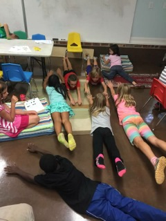 """Jude teaching his classmates the arch hold during """"Share your Talents"""" day."""