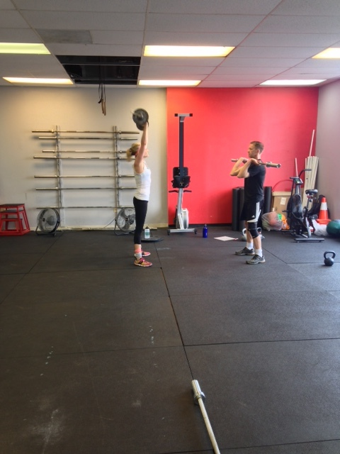 Couples who WOD together...Tracy and Charlie working through the Saturday partner workout.