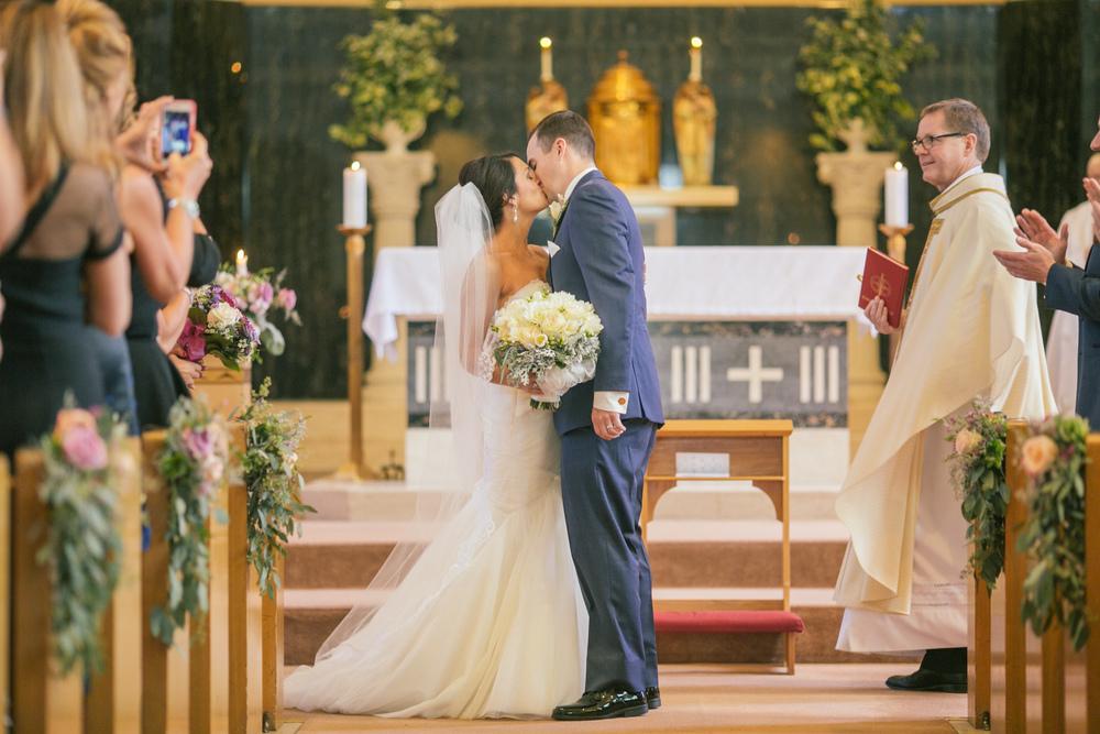 Ashley+Aaron_Acowsay_Cinema_Milwaukee_Wisconsin_Wedding_Kiss.jpg