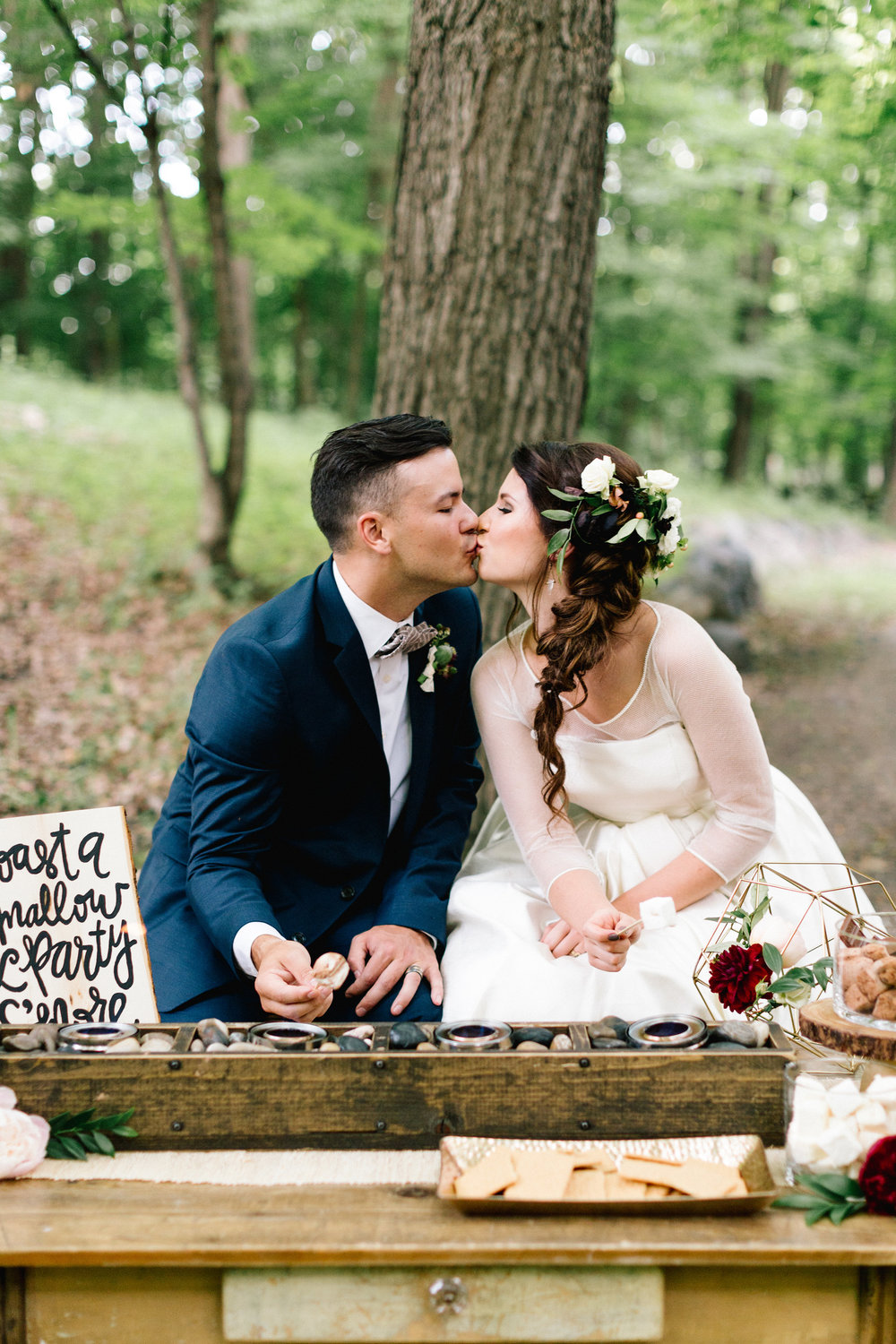 Allison_Hopperstad_Photography_Acowsay_Wedding_Smores_Kissing.JPG
