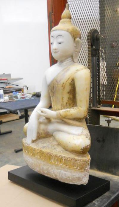 says you would not believe how heavy this antique Alabaster Buddha is. It is a good thing I have the forklift-1..jpg