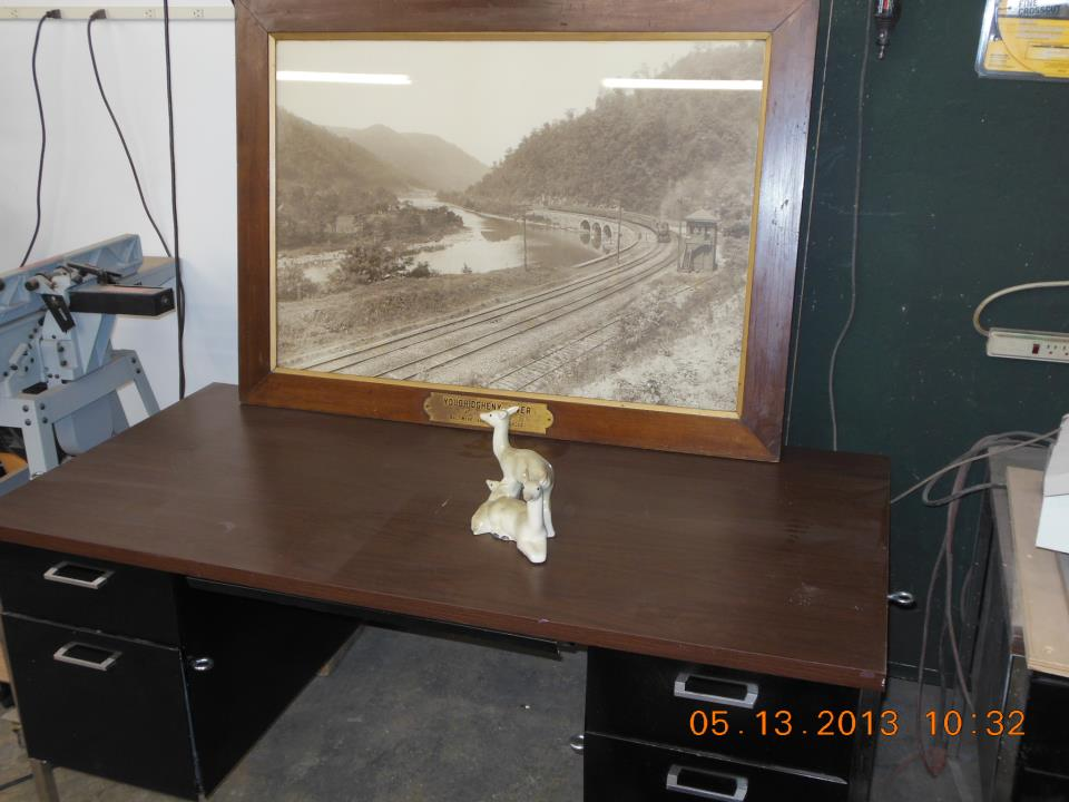 very cool large format photograph of the Ohio and Baltimore Railroad and frame circa 1900 and a less interesting ceramic deer in the workshop today for restoration. The deer has a chip in the ear.jpg