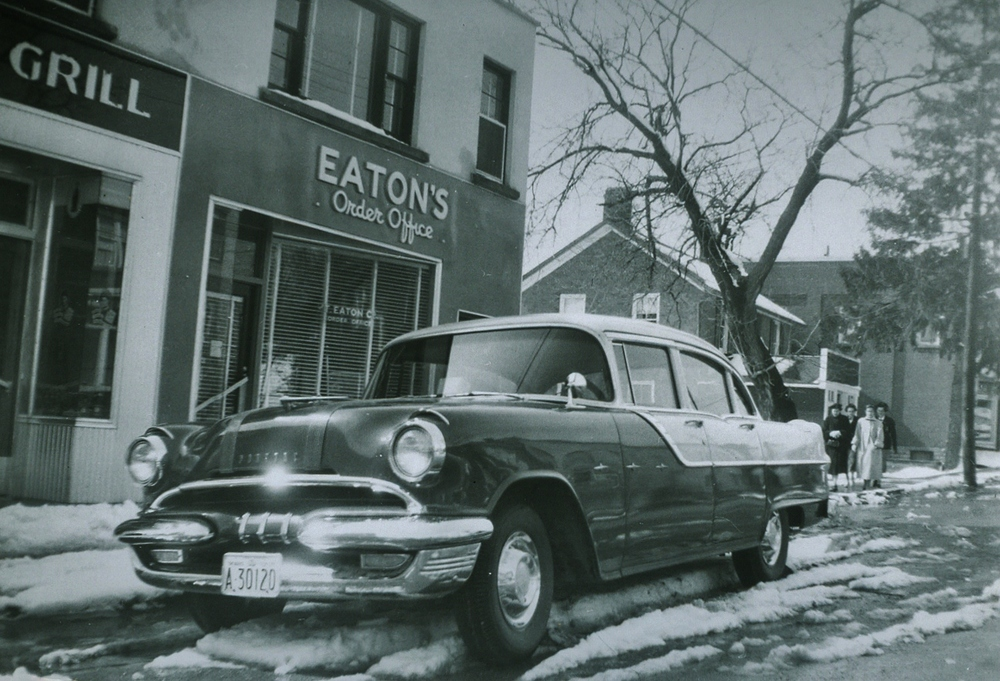 1964Balvers Grill and the Eaton's Order Office       George Mantle's car    ,,,cherry red and cream
