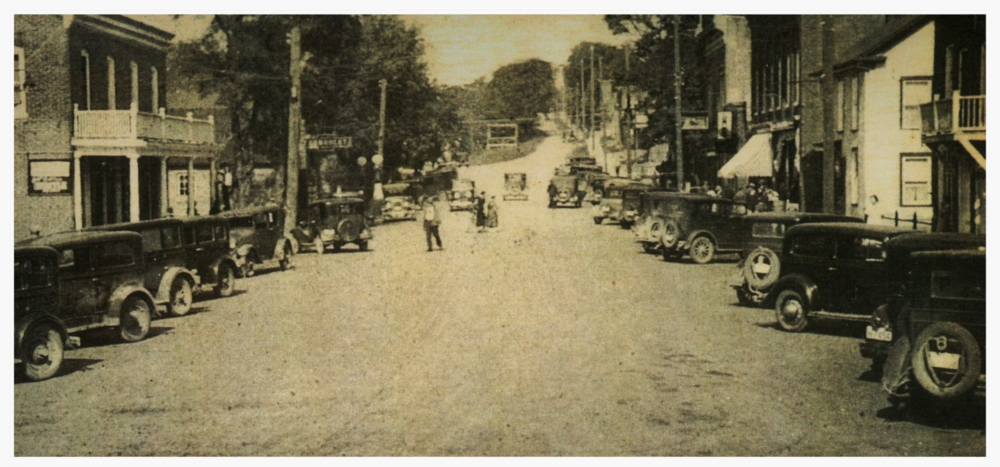 Forsyth, looking north. In the 1930's Marmora was still known for the porches on the main street. The road was wider, the sidewalks narrower, and cars parked on an angle.