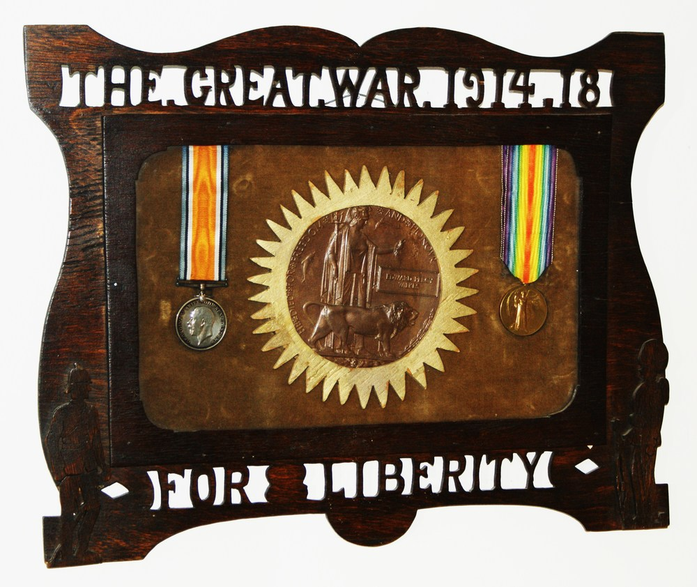War -Memorial frame of deceased soldier with medals and coffin medallion