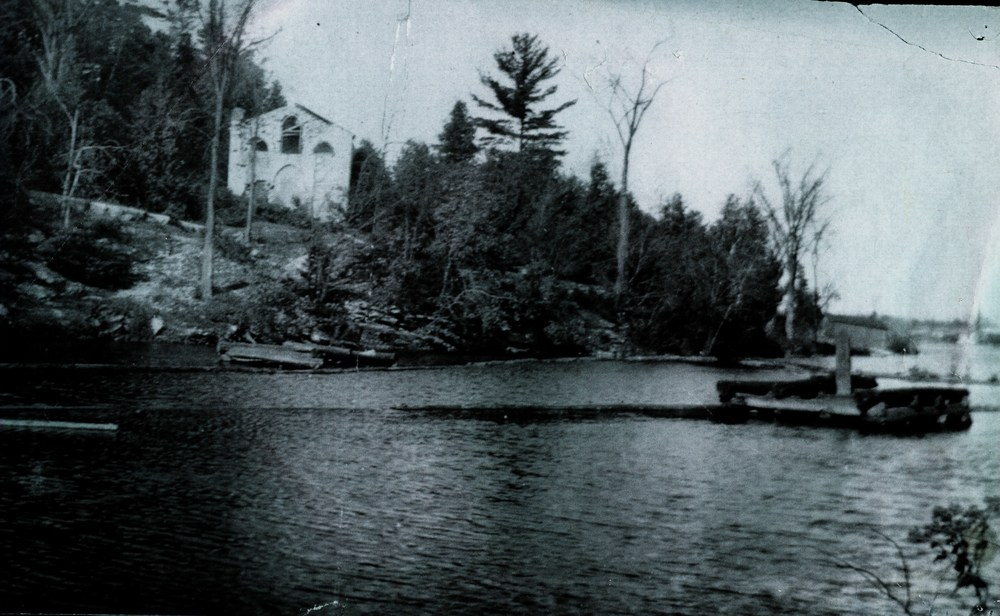 st. Matilda's, above the dam, with log boom on right