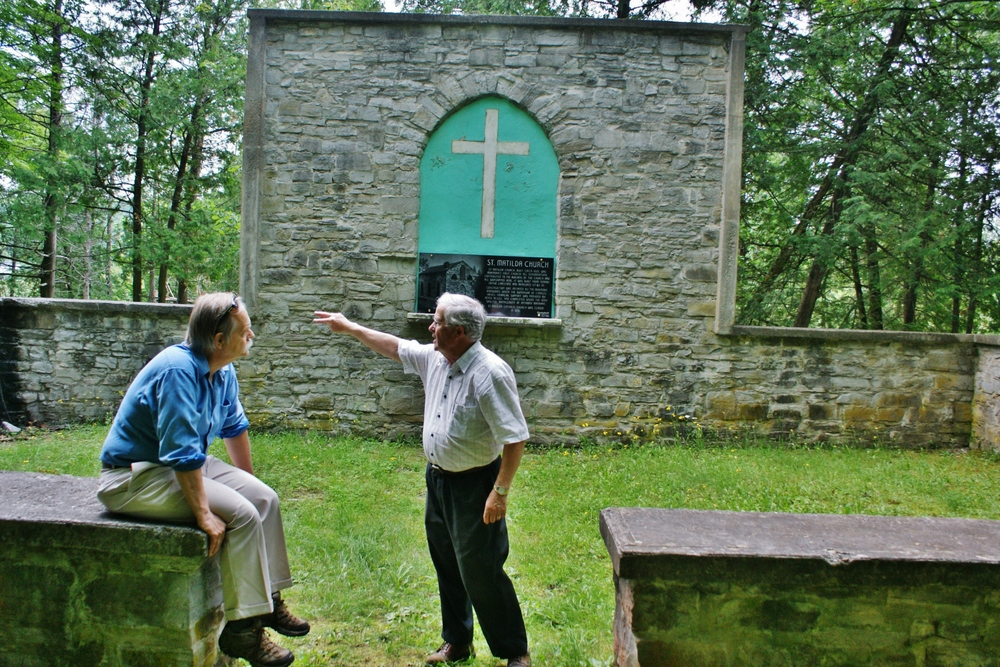 Doug Lynch discusses repairs with Historical Foundation member,  Andre Philpot