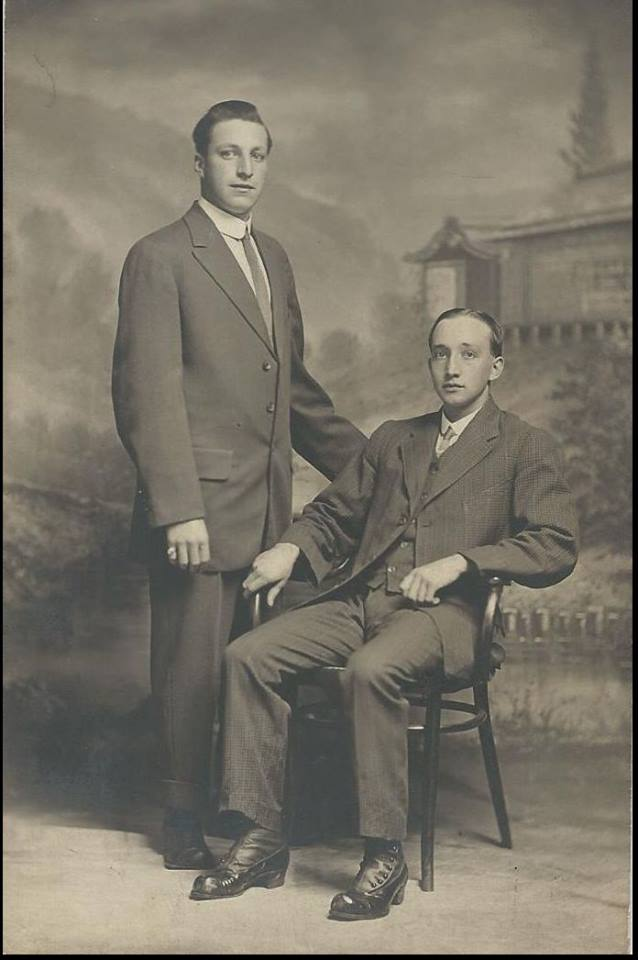Frank Sweet sitting and Jack Sampson standing.