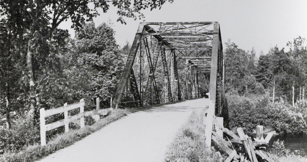The Shanick Bridge -   The iron bridge crossing Beaver Creek 9 miles north ofMarmora and generally called the Shanick bridge, was erected in the summer of 1912. It came in pieces to Marmora railway station, was hauled to the site by teams and wagons belonging to Gillam and Murphy and assembled on the spot. Mr. Ed O'Connor. recalls that Arthur Murphy used a team of Mr. O'Connor's to haul sand and gravel during the construction. On the first river drive in the spring of 1913, the logs jammed at the bridge and it was later raised three feet. At that time Shanick was a thriving farming community of 40-50 families. The bridge is still solid in spite of its age but in dire need of repairs and a paint job.