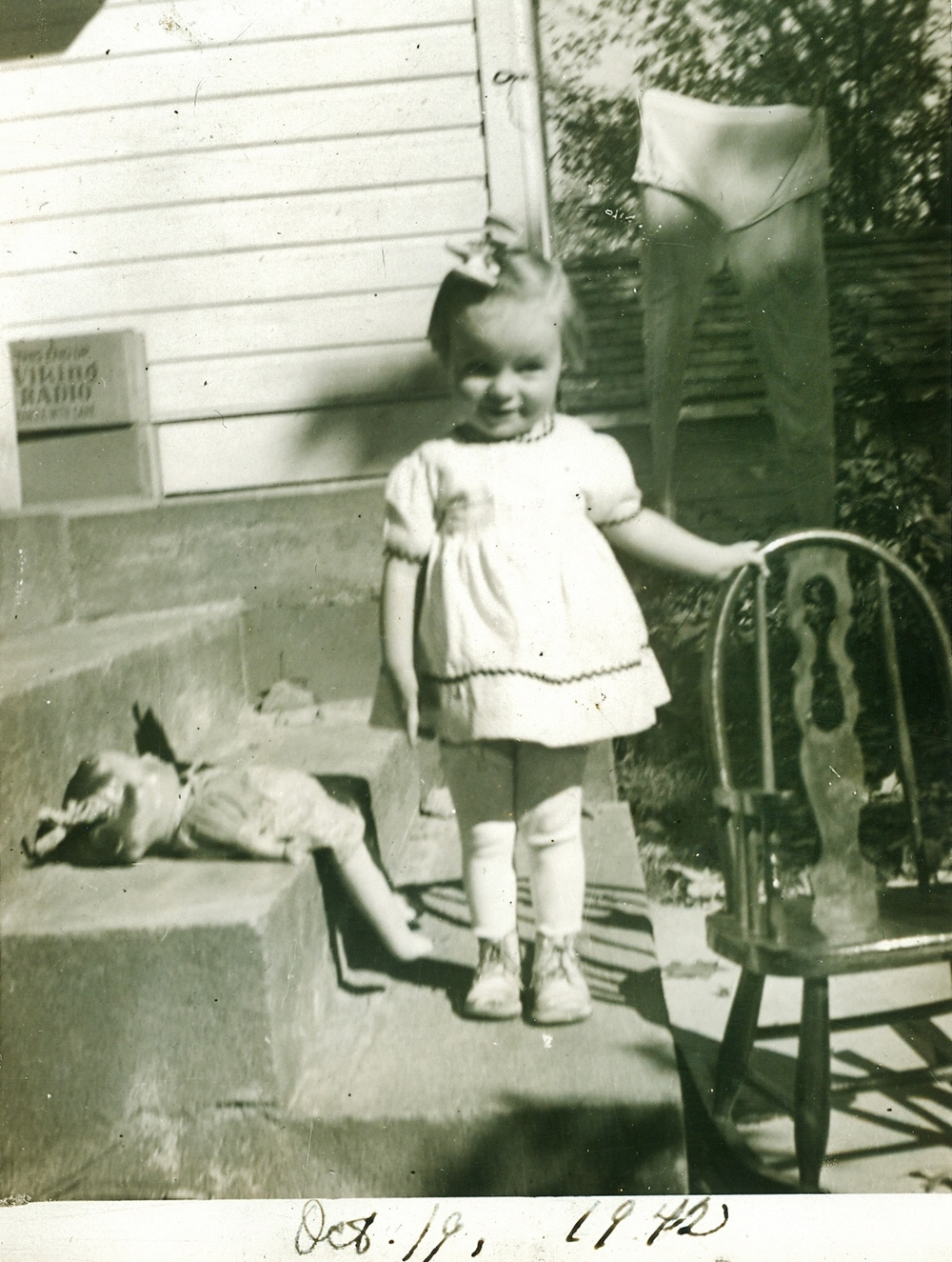 Edna Arlene Campion (McKee)1942 with rocking chair -gift from uncle Graham