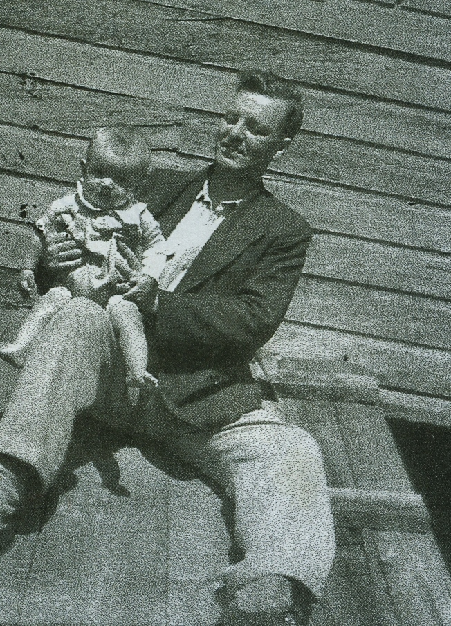 Dr Graeme Squire Mackechnie,  son of Dr. Wiliam Greame Mackechnie, holding his eldest child, Ron.