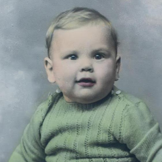 Lou Wilson 1948, wearing sweater knitted by his mother.