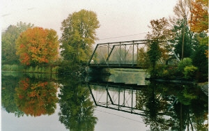 The junction of the Crowe River and the beaver creek showing the original bridge,  now replaced.