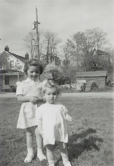 1953 Anne Vanvolkenburg with Nichol house in the background - 16 Main Street