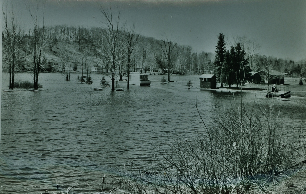"Gordon Bennett's Point at the junction of the Crowe River and the Beaver Creek   Glenn Mawer :  That is Harry Jenkins house boat the landed on Bennet""s lawn   Lionel Bennett:   We gave it back to him. That house boat had wheels under it! That's how deep the water was."
