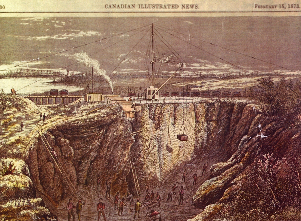 Blairton Mine,  Canadian Illustrated News 1873  The main pit covered about an acre of ground and was 125 feet deep while  the deepest point in the lower mine was only about 60 feet.       The hill above the  lower mine near the lake was a favourite observation site, especially on a sunday  afternoon.      There are many names carved in the stone on this hill.