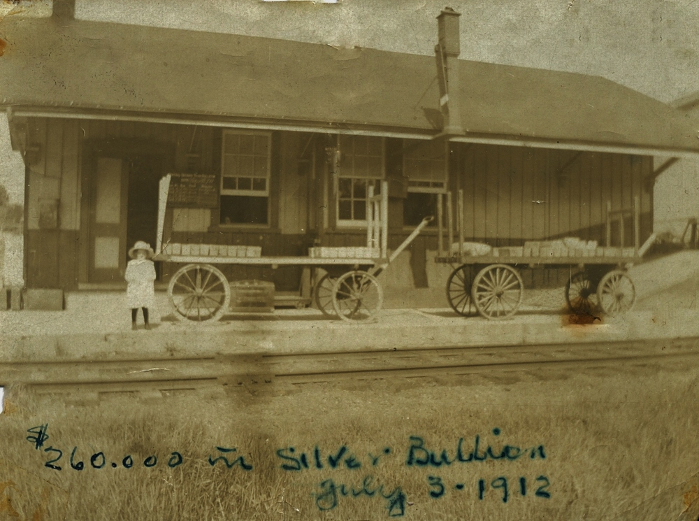 gRACE WARREN ON THE WOLFE STATION PLATFORM AWAITING HER TRAIN, ALONG WITH $260,000.00 IN SILVER BUILLION FROM dELORO