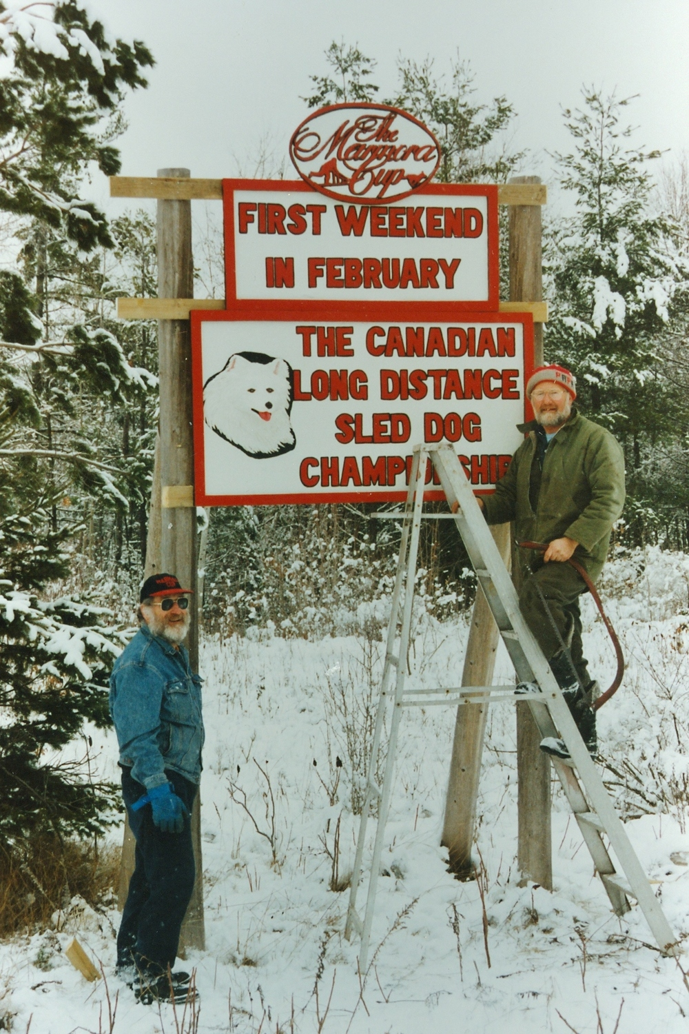 Norm Bradley and Otto Vallinga with new highway sign