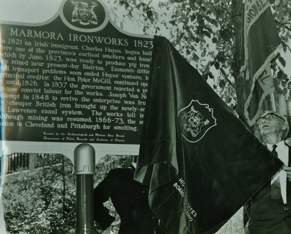 Ed O'Connor unveiling the ironworks plaque dedicated by the Ontario Heritage Foundation