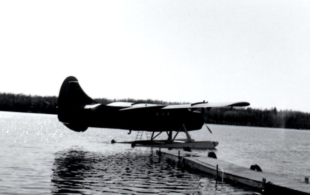 Otter aircraft loaded with fish, Cordova Lake. c.1969