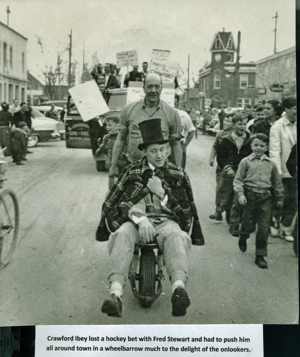 Parade - Crawford Ibey,  Fred Stewart sitting.jpg