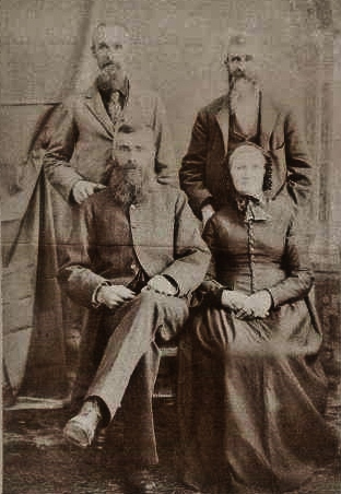 Sitting are Jane Gladney Minchin and her second husband,      Richard Laycock.      Standing are her two sons from her first marriage to Daniel Minchin - John on the left and William Henry on the right.