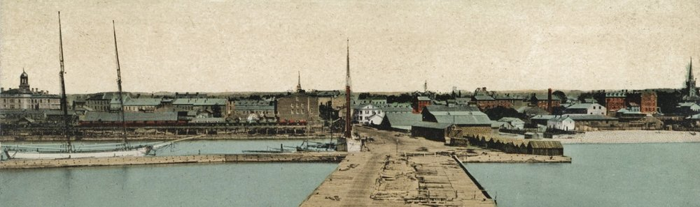 Cobourg Harbour with schooner and ore cars on raised trestle
