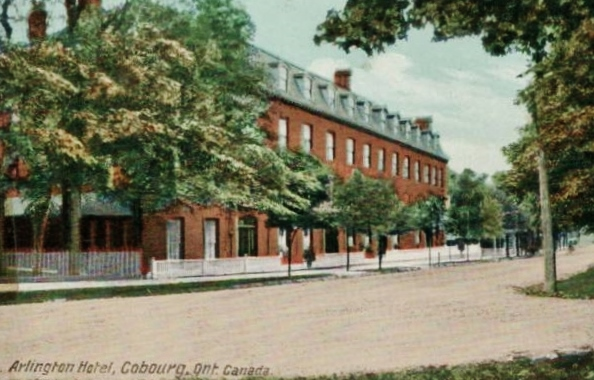 Arlington Hotel, c. 1915, built by George Shoenberger and William Chambliss, was the first of many Cobourg hotels designed to cater to affluent Americans. It contained 150 rooms, of which 120 were bedrooms with private parlours. It had a dining room, bar, games room, parlour, commercial rooms and barber shop.   c. 1910Was located on King Street East, opposite College Street. The building was demolished and the land is now part of Victoria Park