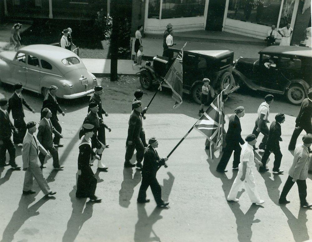 Legion Parade Red Barlet carrying flag.jpg
